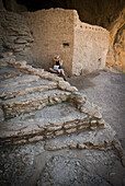 A young woman in her twenties visits Gila Cliff Dwelling National Monument, New Mexico.