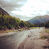 Fly fishing in river near the mountains in Alaska.