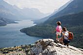 Mother And Daughter Enjoy View At Waterton Lakes National Park, Alberta Canada