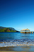 'A covered shelter the end of a pier off Hanalei beach; Kauai, Hawaii, United States of America'