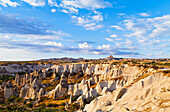 'Fairy chimneys in the rugged, barren landscape of Honey Valley; Cappadocia, Turkey'