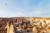 'Hot air balloons in the sky above the fairy chimneys; Goreme, Cappadocia, Turkey'