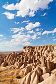 'Fairy chimneys and cliffs in a rugged, barren landscape in Deverent Valley; Cappadocia, Turkey'
