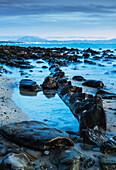 'Wet rocks along the shoreline; Tarifa, Costa de la Luz, Cadiz, Andalusia, Spain'