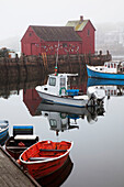 New England, Massachusetts, Close up of small boats in the Rockport Harbor, Red building in background.