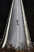 'Silhouette of man on high bridge; Lijiang, Yunnan Province, China'