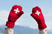 'Mittens with the Swiss flag symbol; Ascona, Ticino, Switzerland'