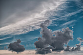 'Storm clouds gather and grow in the sky; Bolivia'