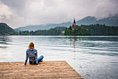 Woman looking at view, Lake Bled, Julian Alps, Gorenjska, Slovenia, Europe