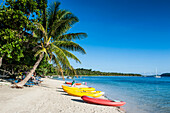 Kayaks on the white sand beach of Nanuya Lailai island, the blue lagoon, Yasawas, Fiji, South Pacific, Pacific