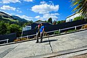 Tourists standing on Baldwin Street, the world's steepest residential street, Dunedin, Otago, South Island, New Zealand, Pacific