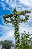Maypole decorated with flowers in celebration of Midsummer's Day, Sweden's most celebrated festival, Sweden, Scandinavia, Europe