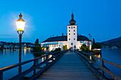 Picturesque Schloss Ort illuminated at dusk, Lake Traunsee, Gmunden, Salzkammergut, Upper Austria, Austria, Europe