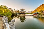 Moon Embracing Pagoda (Deyue Pavilion) as seen from Suocui Bridge in Jade Spring Park, Lijiang, Yunnan Province, China, Asia