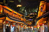 Busy Lijiang Old Town, UNESCO World Heritage Site, at night with Lion Hill and Wan Gu Tower, Lijiang, Yunnan, China, Asia