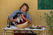 Europe, France, Provence, man, sit, french, table, wine, St. Saturnin les Apt, dog, food, table, fifty