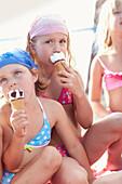 Three girls eating ice cream, lake Starnberg, Upper Bavaria, Bavaria, Germany