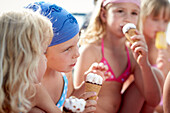 Girls eating ice cream, lake Starnberg, Upper Bavaria, Bavaria, Germany