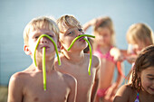 Two boys with fruitgum sticks, lake Starnberg, Upper Bavaria, Bavaria, Germany