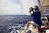 Sailor navigating with a Sextant, Sailing boat, yacht, Sailing