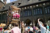Wooden ferris wheel, Renaissance fair in market place, Lubeck, Schleswig-Holstein, Germany