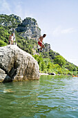 Man jumping from a rock into water, Herault gorge, Saint-Bauzille-de-Putois, Ganges, Herault, Languedoc-Roussillon, France