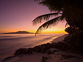 Beach in the evening light, Anse Gaulettes, La Digue Island, Seychelles