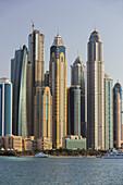 Skyscrapers in the Dubai Marina from the Palm Jumeirah, Dubai, Unites Arab Emirates, UAE