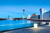 Modern buildings and television tower in the evening, Neuer Zollhof, Media harbour, Duesseldorf, North Rhine Westphalia, Germany