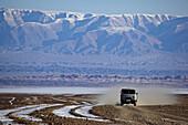 bus in the Gobi desert at wintertime, Mongolia
