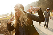 Young woman posing like a rapper, Grosser Alpsee, Immenstadt, Bavaria, Germany
