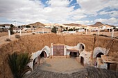 Tunisia, Ksour Area, Matmata, elevated view of underground Hotel Sidi Driss, once a set for the film Star Wars