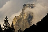 Half Dome emerges from storm clouds at sunset, Yosemite Valley, Yosemite National Park, California