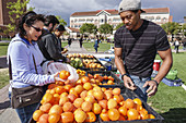 California, CA, Los Angeles, L.A., Downtown, LA, USC, University of Southern California, campus, university, college, higher education, McCarthy Quad, farmer's market, shopping, fruit, navel oranges, Hispanic, Black, woman, man, student, vendor.