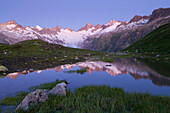 Oberaarhorn, Switzerland, canton Bern, Bernese Oberland, Grimsel area, mountains, lake, water, daybreak, reflection, glacier