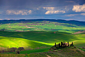 San Quirico dOrcia, Italy, Europe, Tuscany, Crete, hill, fields, houses, homes, farm, clouds, light mood, shade, cypresses