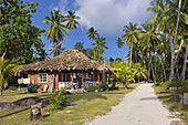 Typical house between palm trees, La Digue Island, Seychelles, Indian Ocean.