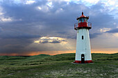 Lighthouse Listg West with dramatic sky, Sylt, North Frisian, Schleswig-Holstein, Germany, Europe.