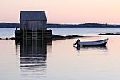 a wharf fish shack and boat in a fishing village near Lunenburg Nova Scotia