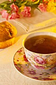 Still life of a cup of tea and a muffin