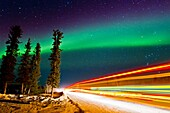 Aurora Borealis Northern Polar Lights with truckers lights on the ice road outside Yellowknife, Northwest Territories, Canada, MORE INFO The term aurora borealis was coined by Pierre Gassendi in 1621 from the Roman goddess of dawn, Aurora, and the Greek n