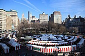 Overview of annual Holiday Market in Union Square, Manhattan, New York City  The market is held during Christmastime every year