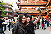 Tourists taking their own photograph at Yu Yuan Garden, Huangpu District, Shanghai, China, Asia  MR