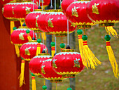 ROLLS OF RED LANTERNS STRUNG UP DURING CHINESE NEW YEAR PERIOD OR OTHER FESTIVE OCCASIONS. RED COLOUR SYMBOLISES, GOOD LUCK, HAPPY OCCASIONS, BRIGHT AND PROSPERITY.Taken in Putrajaya, Malaysia.