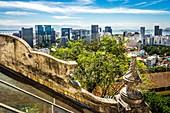The contrast between an historic building (Ruins Park) and modern skycraper in Rio de Janeiro, Brazil.