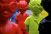 The Watch a collection of 16 brightly-colored goggle-wearing child super hero figures went on display in Pioneer Court Plaza in Chicago.