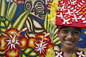 Rarotonga Island. Cook Island. Polynesia. A boy dressed as a dancer of the Cook Island around the Punanga Nui Markets. To the despair of many educated Cook Islanders the expression culture in the popular mind equates to traditional festivals, singing and