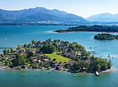 Aerial shot of Fraueninsel, Kampenwand in background, lake Chiemsee, Bavaria, Germany