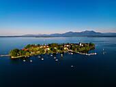 Aerial shot of Fraueninsel, Chiemgau Alps in background, lake Chiemsee, Bavaria, Germany