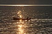 Fishing boat in evening sun, Torri del Benaco, Lake Garda, Verona, Veneto, Italy